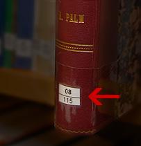 På böcker sitter löpnumret nertill på ryggen.