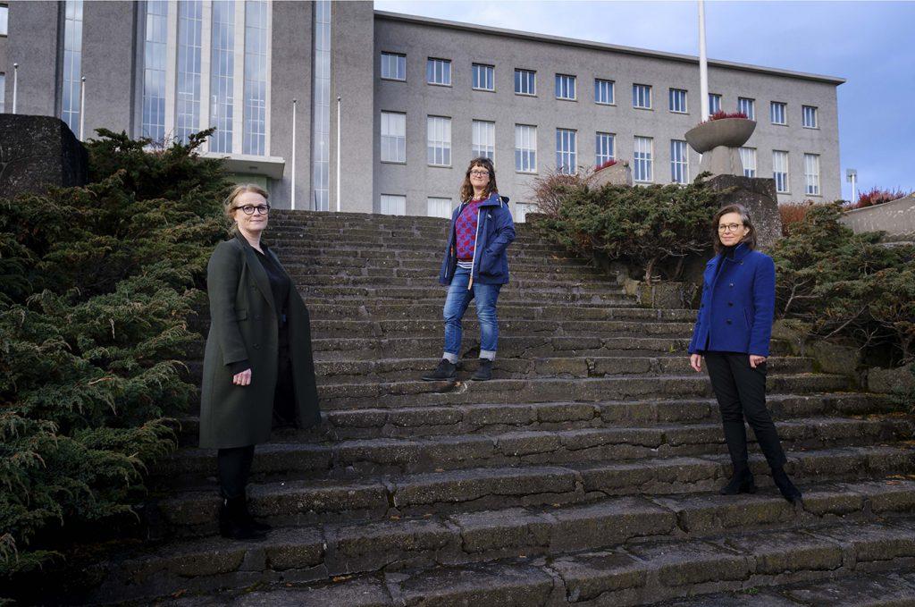 """Kristín Svava Tómasdóttir, Erla Hulda Halldórsdóttir, Ragnheiður Kristjánsdóttir are authors standing in a stair. They are authors of the book """"A Century of Women Voters""""."""