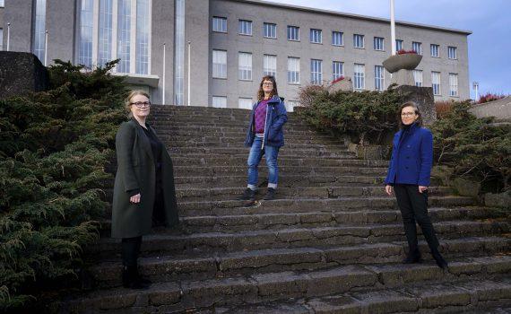 Authors Kristín Svava Tómasdóttir, Erla Hulda Halldórsdóttir, Ragnheiður Kristjánsdóttir at a big stair..